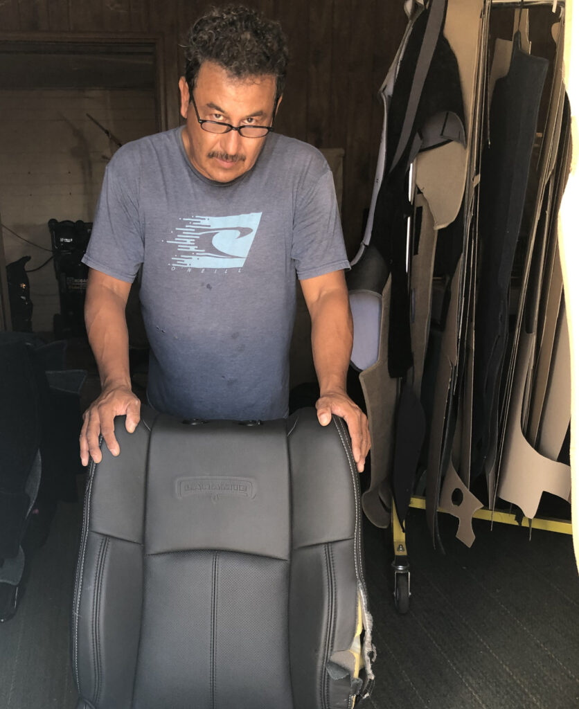 Mario Robles repairs upholstery.